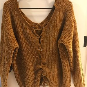 Mustard colored sweater with tie up back